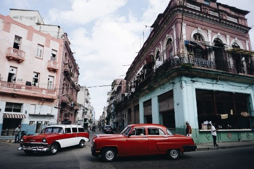 old cars at an intersection in Cuba