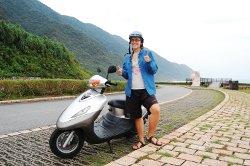 solo female traveler by her motorbike