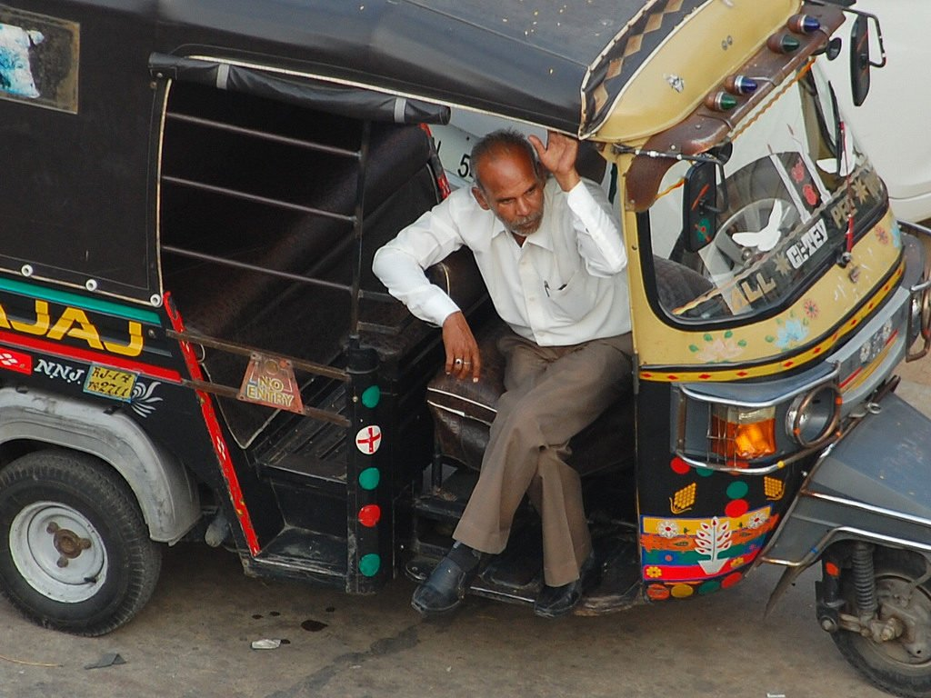 Tuk-tuk and driver in India