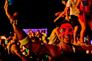 Man in neon parties at the Full Moon Party in Thailand