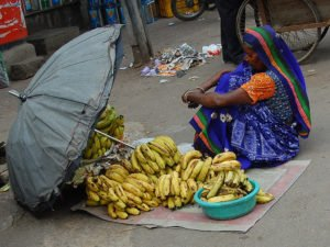 Woman selling bananas in India