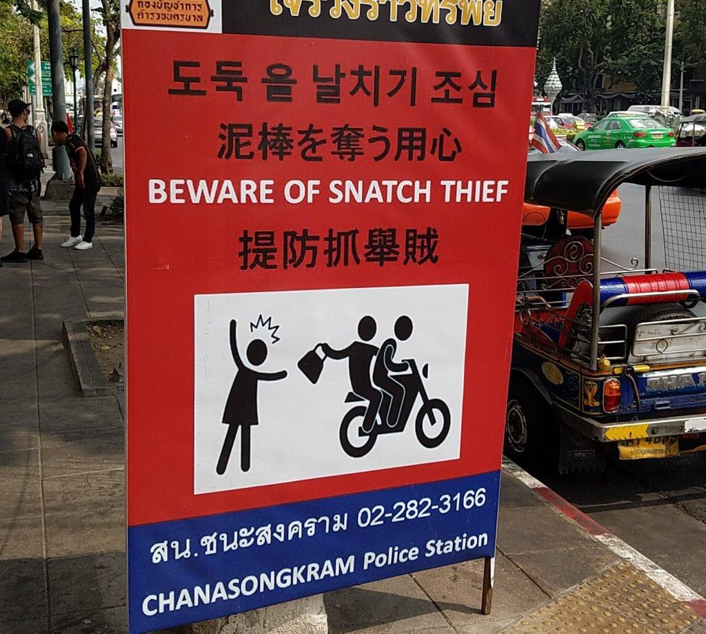 sign warning to keep backpack safe