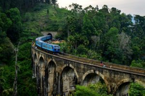 Train crossing Nine Arch Bridge in Sri Lanka